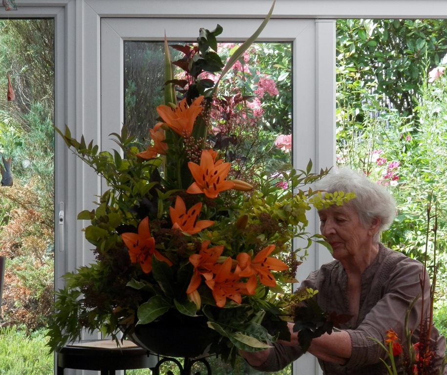Member demonstrating flower arrangement