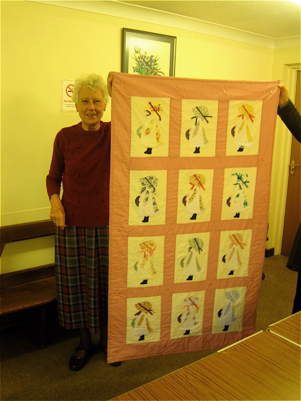 Sheila Mepham with hand-sewn quilt