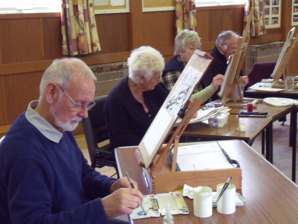 Geoff concentrates on his watercolour