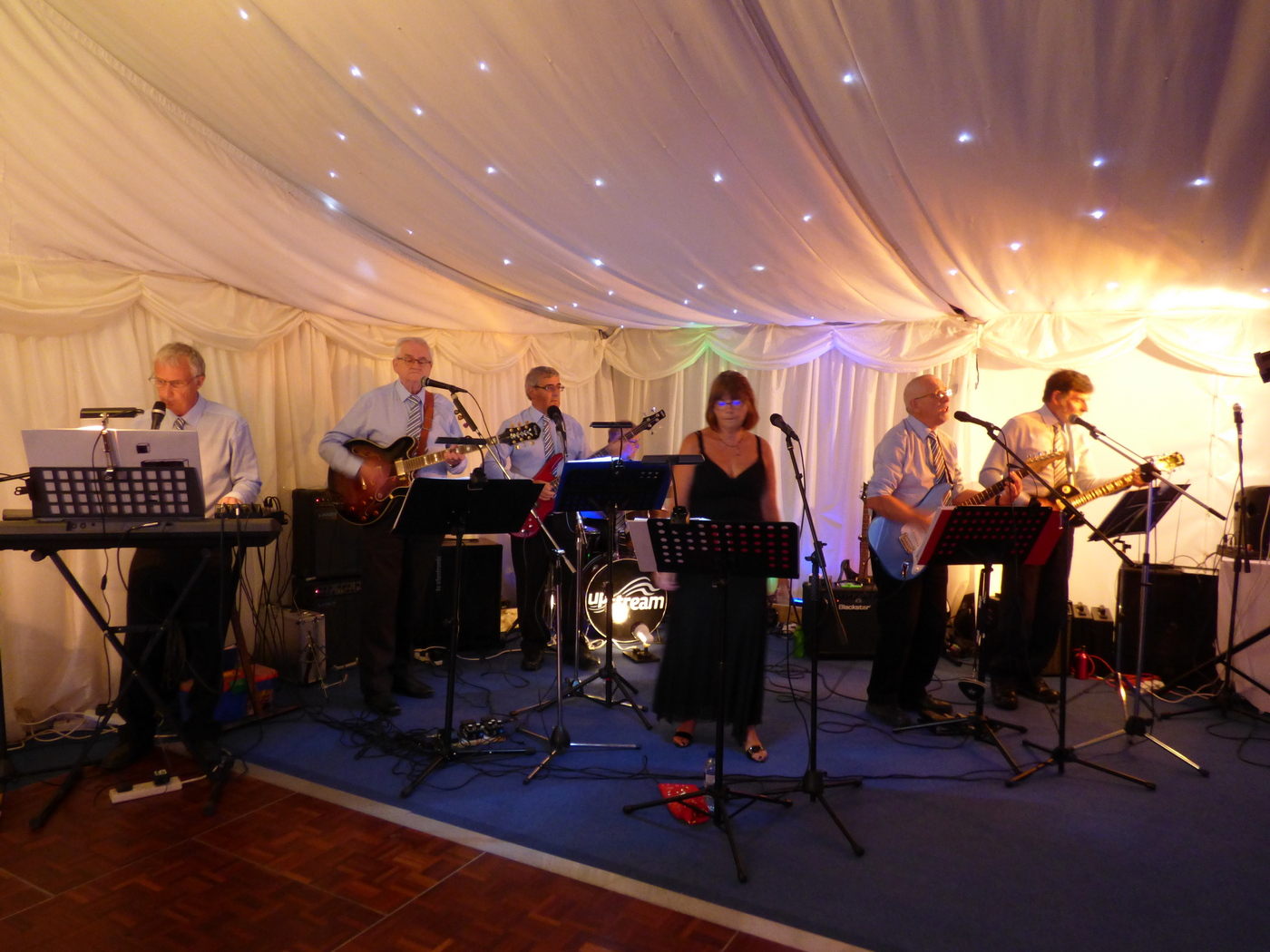 Upstream performing at Rotary event