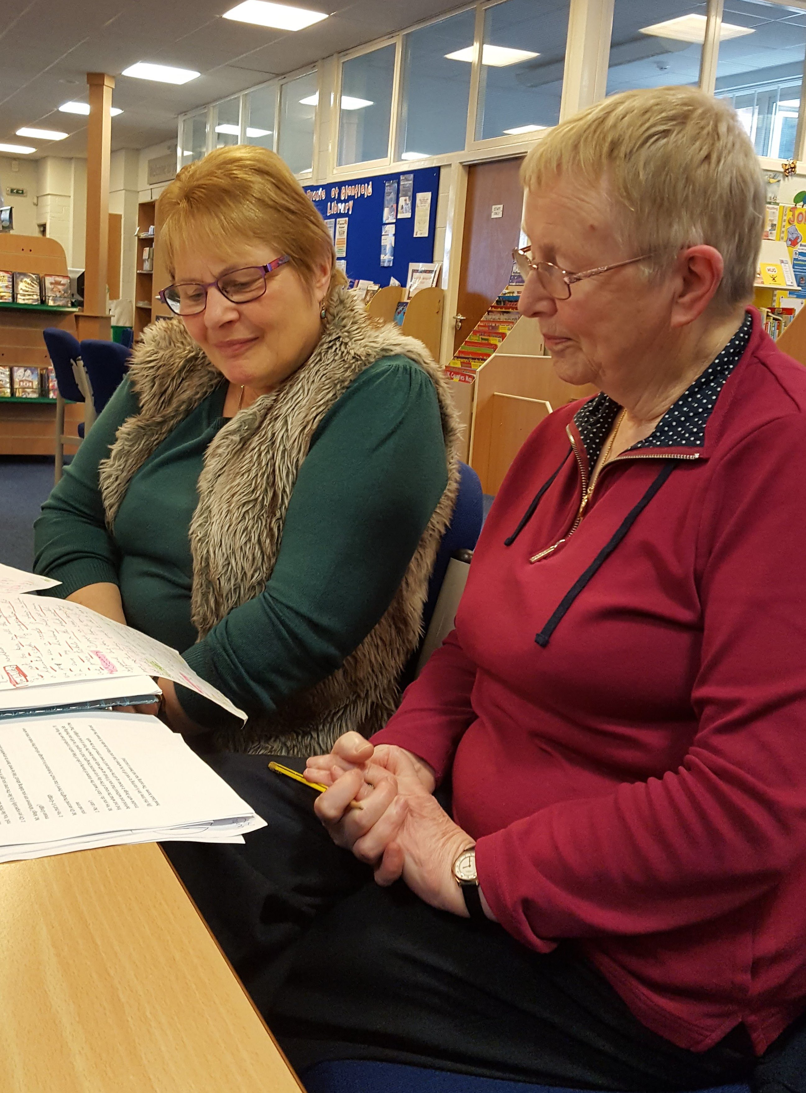 Jan and Sue studying the script