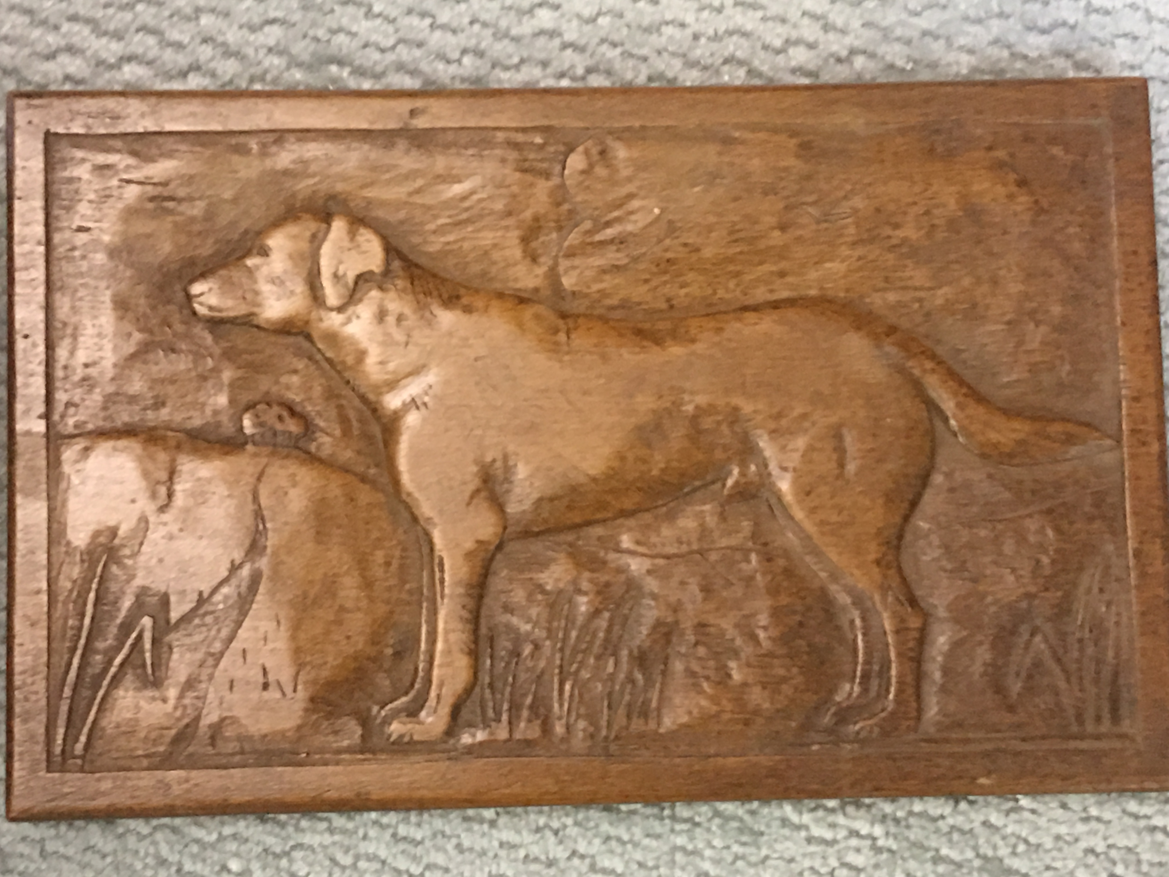 Carving of a dog