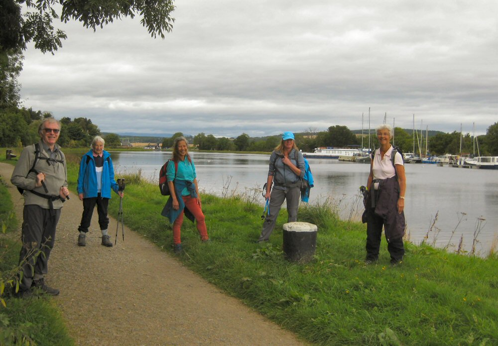 Walking group by the canal