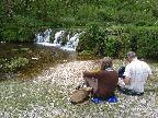 Relaxing besides a Lathkill Dale cascade