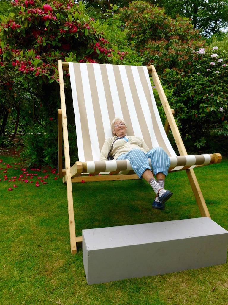 Sue resting in a large deck chair