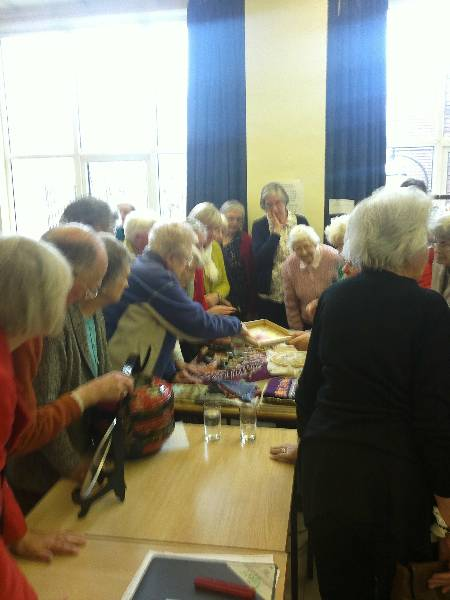 Folk crowding round a Display Table