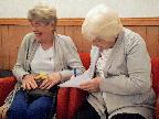 MAVIS AND PAT ENGROSSED IN THE QUIZ