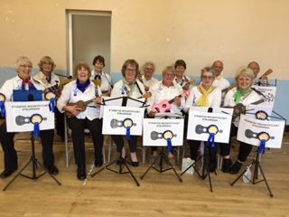 Strummers playing at a U3A Meeting