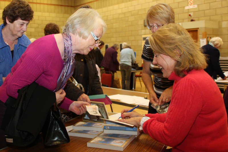 Countess of Carnarvon signing her book