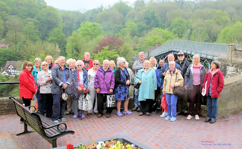 The group in front of the iron bridge