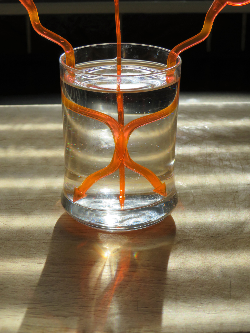 Glass with straws by Phil Gregory